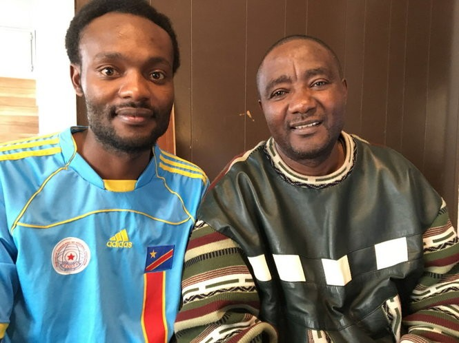 "Though Fanchon Salukombo, right, has been living in Cleveland since 2004, he recently said, ""Home is home. If there is peace in the Congo, the next morning I'm taking my flight. I go back to the Congo."" His son, Makorobondo ""Dee"" Salukombo, who grew up in the Congo, Uganda and the U.S., now regards both America and the Congo as his home. ""I don't see one without the other,"" he said. (Brian Albrecht/The Plain Dealer)"