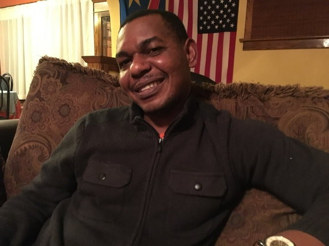 "Happy Wetshindjadi, who once was a French tutor in the Democratic Republic of Congo, has lived in Cleveland for the past eight years, and recently said, ""This is my home now. I have my family here. I feel more American."" (Brian Albrecht/The Plain Dealer)"