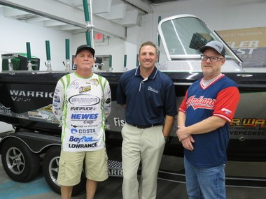 (L-R) Fall Brawl founder Frank Murphy, Erie Marine Sales representative Brian Zarembski and Erie Outfitters owner Craig Lewis pose in front of the top prize Warrior boat.