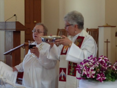 Susan Guzik, left, is shown as a deacon celebrating with Bishop Mary Eileen Collingwood. (Photo courtesy of Mary Eileen Collingwood)