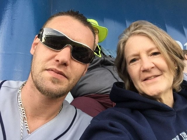Bryan Smith, left, is seen here with his mother Kathie Smith at a Cleveland Indians baseball game in 2015.