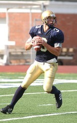 Tom Arth as a JCU quarterback, where he led the Blue Streaks to their last playoff appearance -- in 2002.