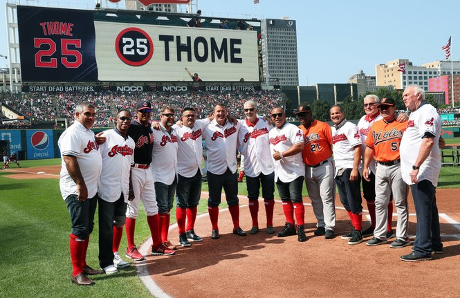 Cleveland Indians Hall of Famer Jim Thome poses with teammates.