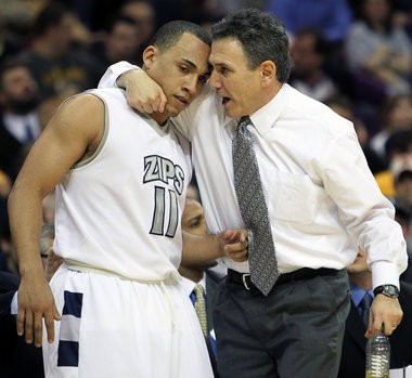 """""""My only concern is expectations [at Akron] have been raised so high,"""" Zips basketball coach Keith Dambrot (with guard Alex Abreu during the March MAC postseason tournament) says about staying in the Mid-American Conference. """"It's like some people expect us to win an NCAA tournament game every year. But I like this job, I really do. And I think we can do even more here."""""""