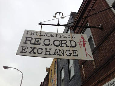 The sign hanging in front of the Philadelphia Record Exchange is the same piece of wood that Greg Harris fished out of dumpter almost 30 years ago.