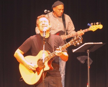 Singer-songwriter-activist Johnny Clegg used his time on the E.J. Thomas Hall equally to entertain and educate.