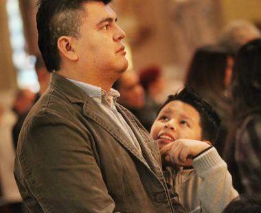 Ricardo Ramos and his son Ricardo Jr. at St. Casimir Church.