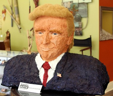 Donald Trump, reimagined as a bust made of dryer lint, chicken wire, a milk jug and paint.
