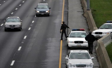 A state trooper pulls over a van during a traffic stop on the eastbound lane of I-90 at W. 117 St. Friday, October 26, 2007. State Rep. John Becker has introduced a bill in the Ohio House that would allow Ohio drivers to warn each other about police radar traps by using their headlights.