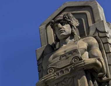 Perhaps this Guardian of Traffic should be holding a tow truck?