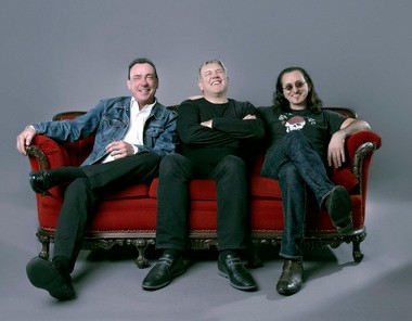 Three guys who have been friends and co-workers since 1974 will be inducted into the Rock and Roll Hall of Fame on Thursday. From left are drummer Neil Peart (sporting a rare smile), guitarist Alex Lifeson and bassist-keyboardist-lead singer Geddy Lee, collectively known as Rush.  Â