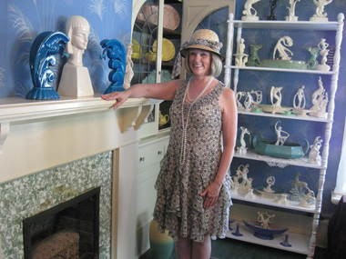 Dina Blumel, of the Cowan Pottery Museum Associates, acts as a tour guide in the re-created Cowan Pottery display room during a recent open house.