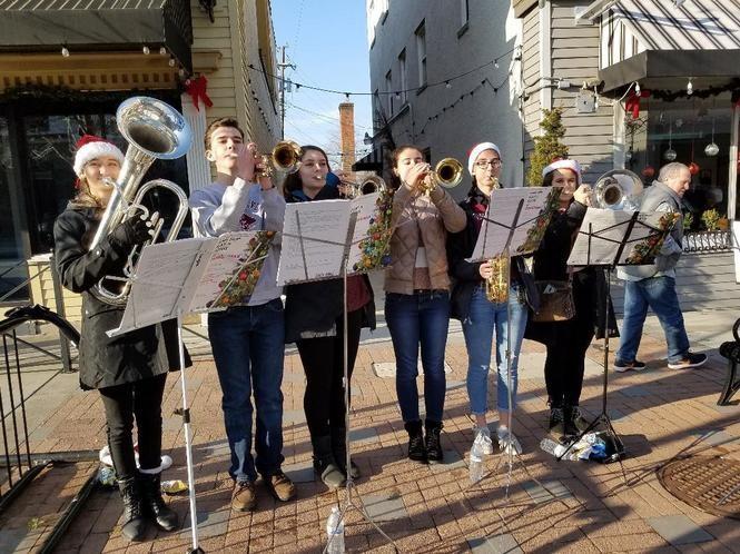 Rocky River High School music students entertained at the Downtown River Holiday Walk. From left: Elizabeth Douglas, Jack Sierputowski, Jillian Champoir, Amanda Cini, Lillian Beach and Sophia Hess.