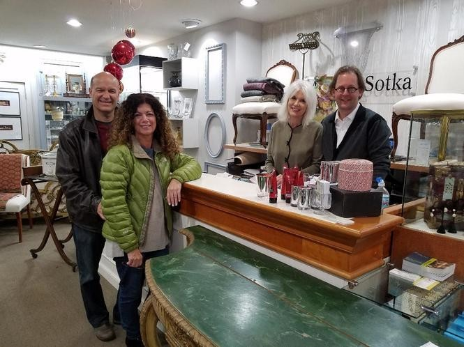 Mitchell Sotka Antiques. From left: Mary and Ken Patsey of Rocky River, gallery manager Cynthia Deering and owner Mitchell Sotka.