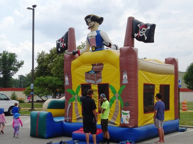 Youngsters enjoyed playing on the inflatables at River Days, including this pirate-themed bounce house.