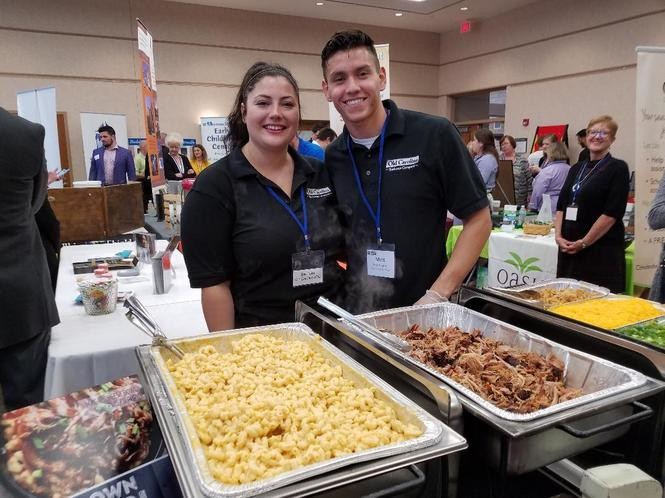 Erin Bolon and Matt Deaton dish up Rocky River's Old Carolina Barbecue and macaroni and cheese to expo goers.