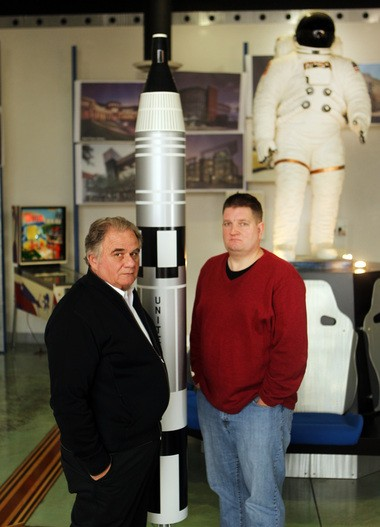 Space artifacts fill the lobby of the Copley complex where the Thomarios company does aerospace restoration work. CEO Paul Thomarios, left, and University of Akron business professor Andrew Thomas have written a book about the history and restoration of NASA's Saturn V moon rocket.