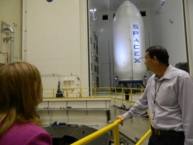 NASA deputy administrator Lori Garver, left, and Plum Brook space environment simulation facilities manager Jerry Carek eye SpaceX's rocket fairing, which is undergoing testing at the Sandusky complex.