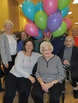 Rosalind Gross (seated right), and daughter, Nancy, celebrate Rosalind's 98th birthday with a few friends.