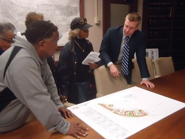 Curt Garrett, project manager with Vintage Development Group, meets with neighbors May 3 to go over plans for the Townhomes of Van Aken, to be built along the RTA Blue Line in Shaker Heights.
