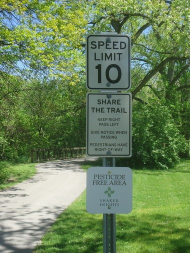 """These """"Pesticide-Free"""" signs have been cropping up all over Shaker Heights this year, this one along the Lake-to-Lakes connector trail."""