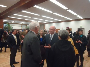 Interim Shaker Heights Mayor David Weiss meets with well-wishers after being sworn in at the Stephanie Tubbs Jones Community Building on April 9.