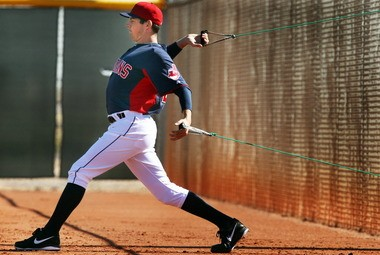 Indians pitcher Trevor Bauer stretches his arms last month before pitching to hitters for the first time at spring training.