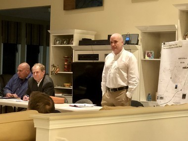 Solon Mayor Ed Kraus (seated, second from left) and Planning and Community Development Director Rob Frankland (standing) at Tuesday night's meeting about the proposed Solon to Chagrin Falls Trail.