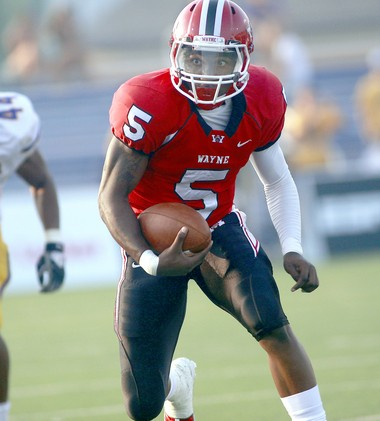 Braxton Miller runs with the football during his senior year at Huber Heights Wayne in 2010, when he led Wayne to the Division I state final against St. Edward.