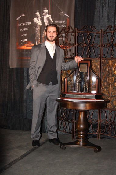 Mount Union junior quarterback Kevin Burke, of Westlake, poses with the Gagliardi Trophy he was awarded Wednesday night in Salem, Va., as the outstanding football player in NCAA Division III. He is the first junior to win the trophy.