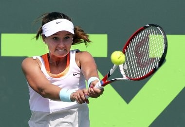 American Lauren Davis returns a shot during first-round action at the Sony Open in Key Biscayne, Fla.