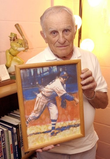Joe Simenic with a print of Indians pitcher Mel Harder, one of Simenic's favorite players. The two became close friends after Harder retired.