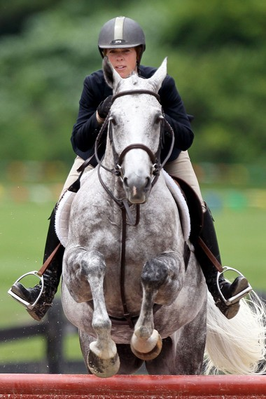 Stefanie Portman and her horse Leopold compete in the Open Hunter class of the Chagrin Valley Hunter Jumper Classic in 2013.