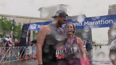 Dan Horvath and Stephanie Lesco got engaged at the finish line of the Cleveland Marathon on Sunday. The couple first met at the marathon three and half years ago. (Branson Wright / The Plain Dealer)