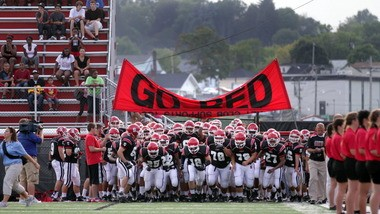 Steubenville football players take the field before a football game in the weeks after two of its members were charged with raping a 16-year-old girl from a nearby town.