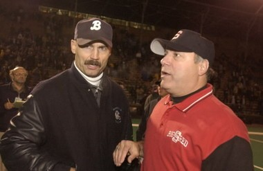 Steubenville head coach Reno Saccoccia, in the red jacket, talks with another coach in this 2003 photo.