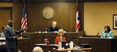 Defense attorney Walter Madison, left, cross-examines states expert witness, forensic scientist Laureen Marinetta, right, as Judge Thomas Lipps, center, listens on the fourth day of the rape trial against two Steubenville teens in juvenile court on Saturday.
