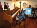 """Author Claudia Gagliani, 10, of Strongsville, with her first published book, """"the Vampire Squid."""""""