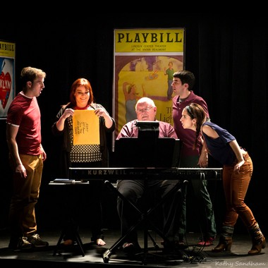 The cast fills out the form to enter the theatre festival competition.