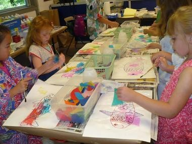 Children create fish art at Brecksville Center for the Arts.