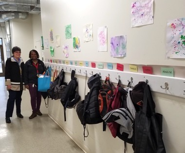 Kathy Henry, manager of marketing communications, and Cressida Davis-Dansby, assistant manager of Camp Cheerful, show off the beautiful clubhouse and participants' artwork.
