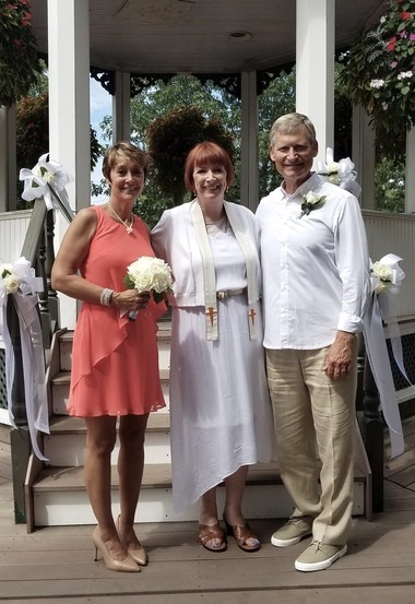 Roberta Stack, Shirley MacFarland and Dan Kalinsky after their wedding in the gazebo in Brecksville Square.