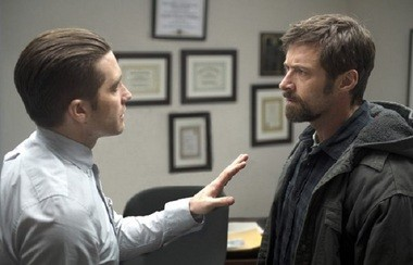 Staying cool: Gyllenhaal's dogged cop tries to keep Jackman's angry dad calm.