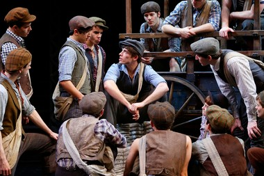 Corey Cott, center, with the cast of 'Newsies', including Ben Fankhauser, right, with hands on his knees.