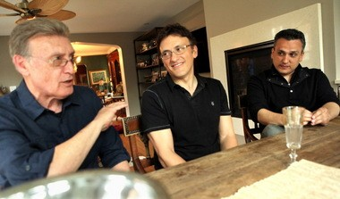"Basil Russo, left, sits in on a conversation with his two sons, filmmakers Anthony, center, and Joe, right, during a Memorial Day get together at their sister's home Monday, May 27, 2013. The Russo brothers were in town directing ""Captain America: The Winter Soldier."" (Gus Chan / The Plain Dealer)"