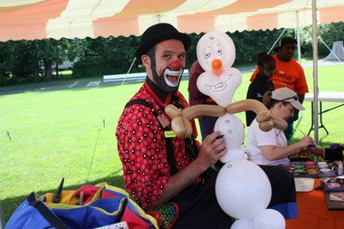 """Flower Clown with one of his creations last year at the Achievement Center for Children's """"Most Excellent Race"""" event."""
