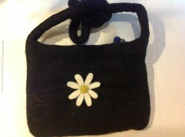 One of the Clevemandu felt purses made in Nepal ($20), sized to carry an iPad.