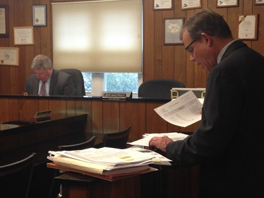 Linndale Law Director Jeff Hastings, right, reads off the names of defendants whose cases would be dismissed before Administrative Hearing Officer Richard Neff makes his ruling.