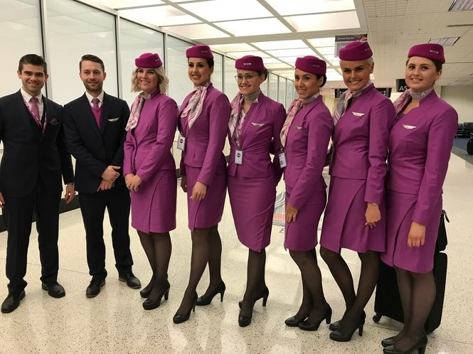 Wow Air flight crews -- both incoming and outgoing -- pose for a photo on the A concourse at Cleveland Hopkins International Airport. (Susan Glaser, The Plain Dealer)