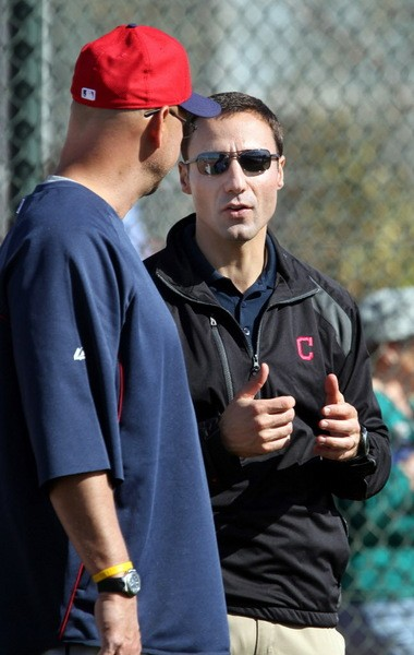Terry Francona and Indians general manager Chris Antonetti talk during spring training in Goodyear, Ariz.